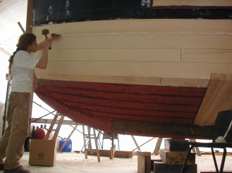 Caulking on the tugboat restoration