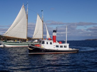 Replica wooden boat and tugboat restoration by Rob Thompson of Windfall Woodworks